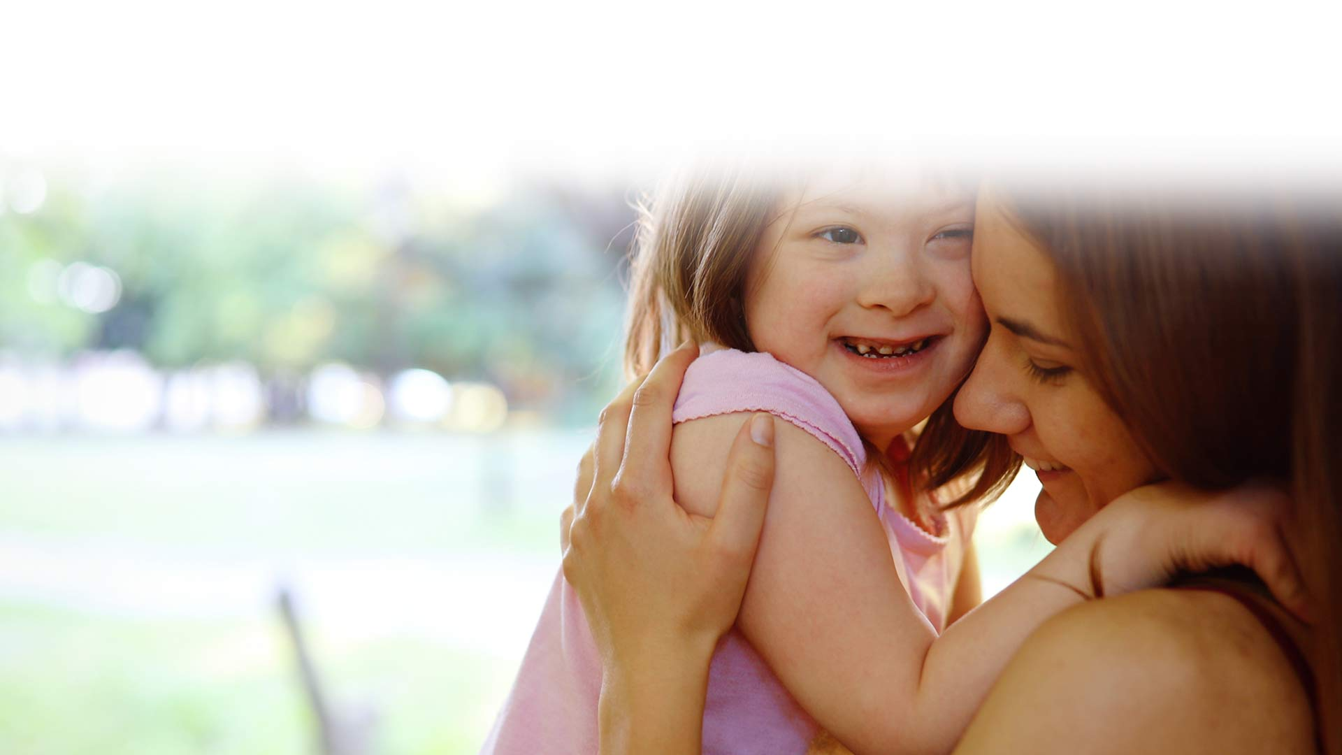 Mom and little girl with Down Syndrome